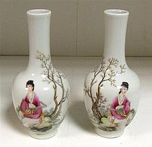 A pair of 20th century famille rose bottle vases