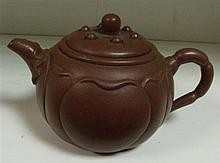 A Yixing tea pot and cover,