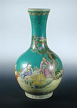 A turquoise green ground bottle vase
