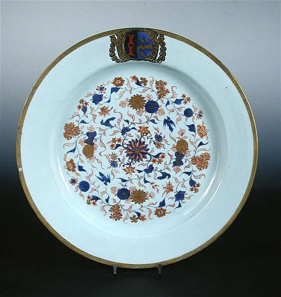 An early 18th century Imari palette armorial dish,