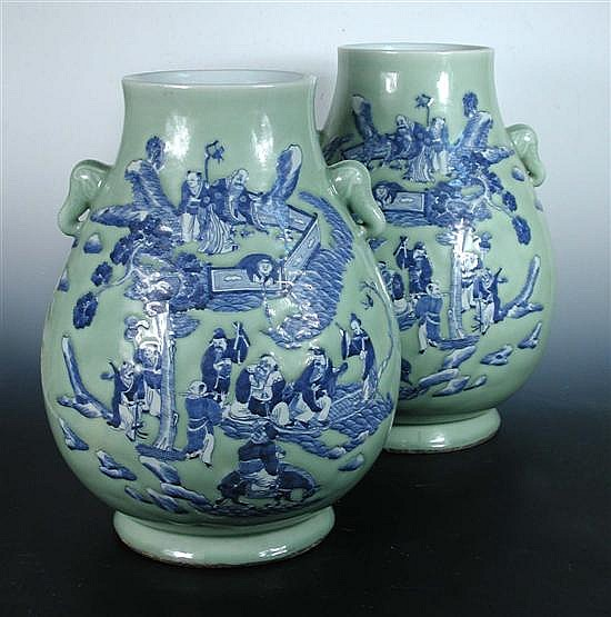A pair of celadon ground blue and white vases,