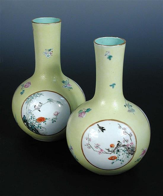 A pair of 19th century bottle vases,