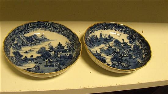 A pair of late 18th century blue and white saucers,