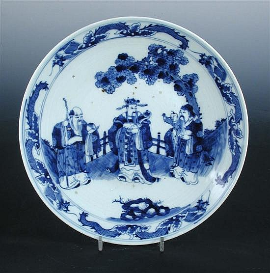 A 19th century blue and white dish and another in the Canton style,