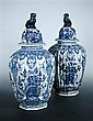A pair of 18th century Delft blue and white vases and covers,