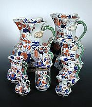 A matched and graded set of nine Mason's ironstone jugs,
