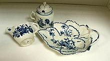 A Worcester blue and white dish, a cream jug and a Caughley mustard pot and cover,