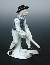 A mid 18th century Meissen figure of a woodcutter after J J Kandler,