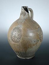 A 17th century Bellarmine without a handle and another larger,