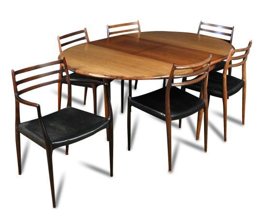 A Danish Rosewood Extending Circular Dining Table And Six Ch
