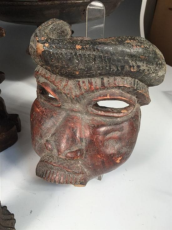 A collection of african tribal carvings and metal objects