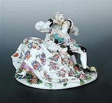 Attributed to Meissen, a late 18th/early 19th century group of the stolen kiss,