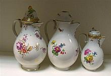 Three 19th century Vienna jugs and three covers,