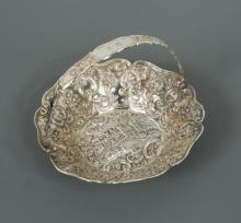 A Victorian silver 'Castle series' sweetmeat basket by Nathaniel Mills,