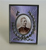 By Fabergé - A silver parcel gilt and lilac enamel decorated photograph frame