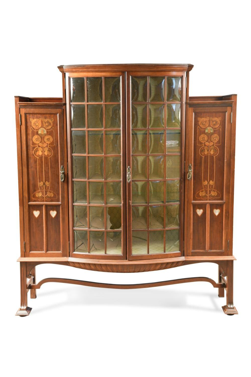 An Art Nouveau display cabinet in the manner of Shapland & Petter, circa 1900,