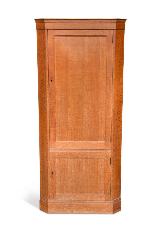 A Heal's oak floor-standing corner cupboard,