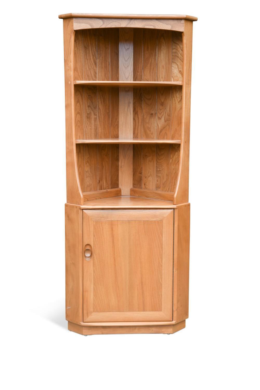 An Ercol elm corner cupboard,