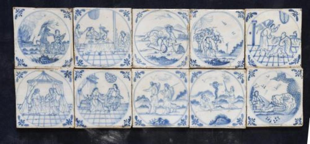 A set of twenty-five 18th century Delft blue and white tiles, probably Bristol,