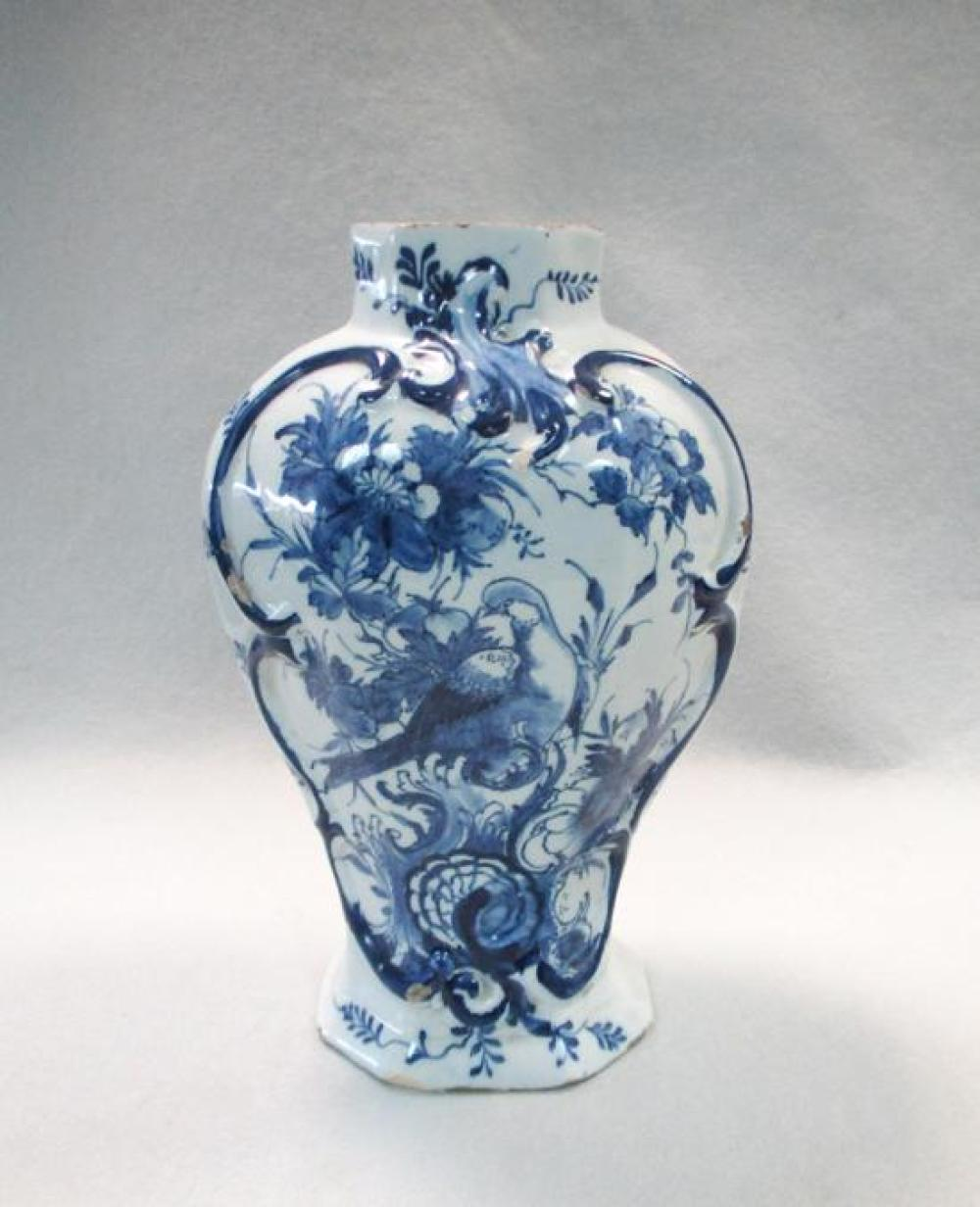An 18th century Delft blue and white vase,