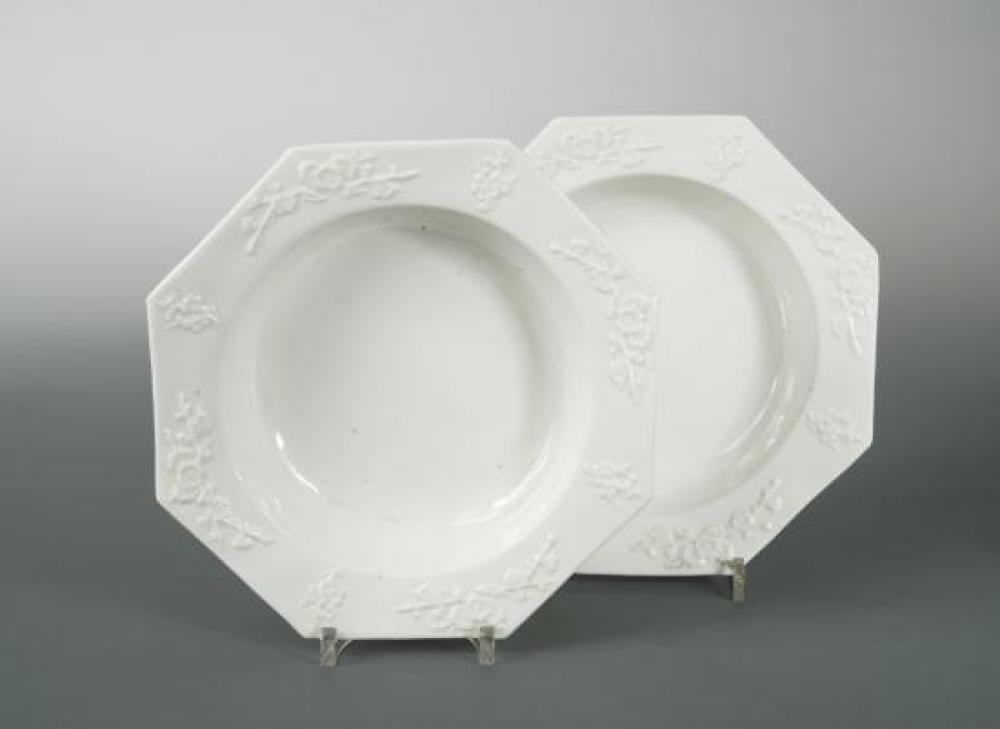 A pair of English porcelain blanc de chine octagonal bowls, probably Bow, circa 1750-52,