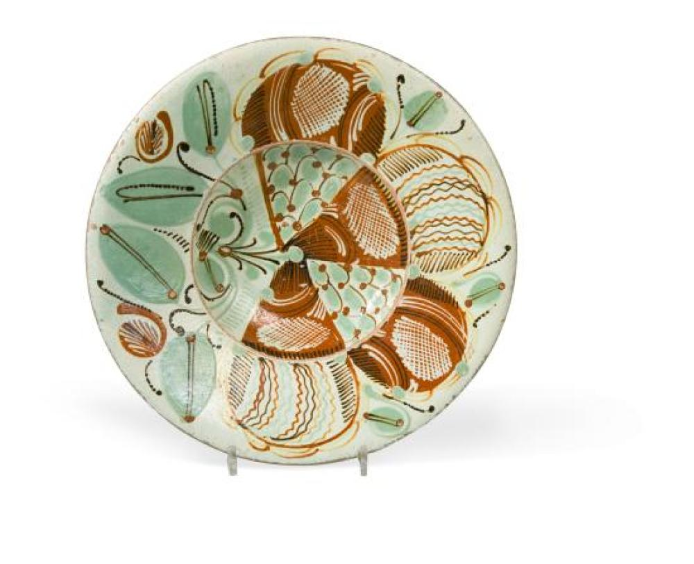 An 18th century Spanish pottery shallow bowl,