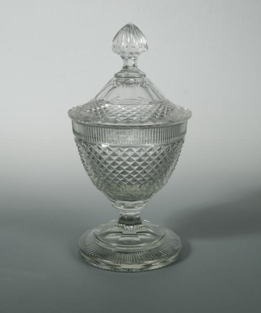 A 19th century hobnail cut glass pedestal vase and cover, probably Irish,