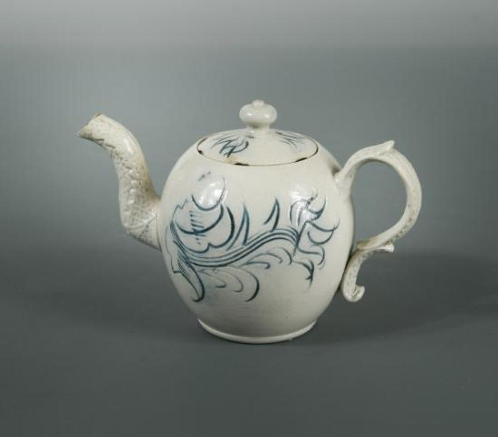 An 18th century Staffordshire salt-glazed miniature teapot and cover,