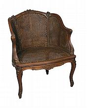A French walnut framed Bergere, circa 1900