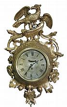 John Goodwin, London, a George III giltwood cartel timepiece,