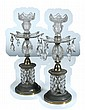 A pair of early 19th century cut glass and ormolu lustre candlesticks,