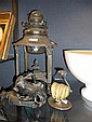 An oil lamp, candle related items and Old Sheffield Plate,