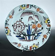 Two mid 18th century large Delft dishes and a blue and white dinner plate, possibly London,
