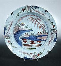 Four 18th century polychrome Delft plates and a dish, possibly Bristol,