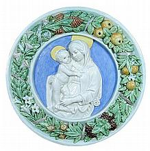An early 20th century Della Robbia style relief roundel