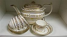 Four Swansea cups, four saucers, a teapot, cover and stand,