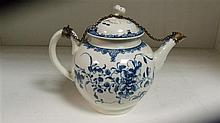 A late 18th century Worcester blue and white tea pot and chain mounted cover,