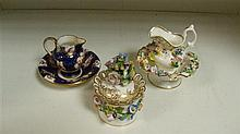 An early Victorian inkwell with two miniature jugs and bowls,