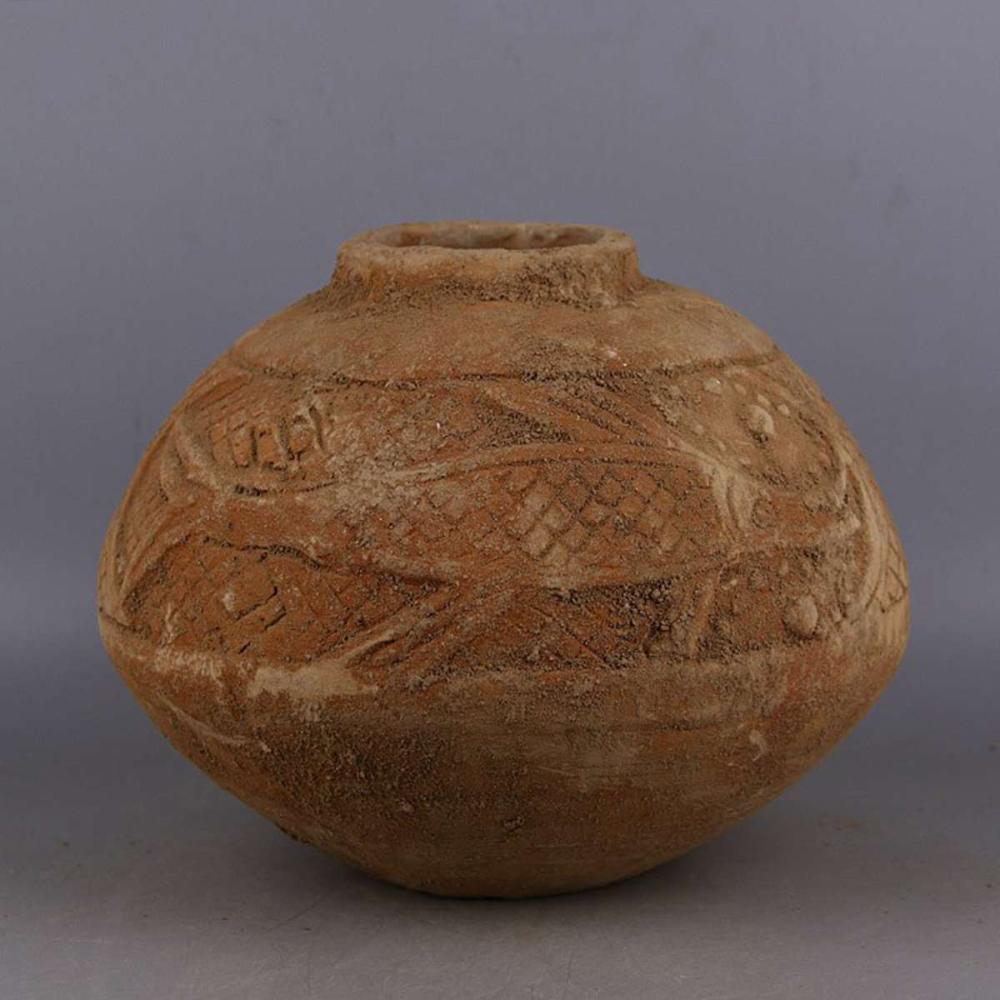 Handmade carvings of fish grain jars