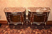 A rare pair of French 19th century serpentine shaped mahogany commodes with