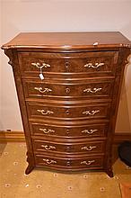 A fine continental 19th century serpentine shaped walnut chest having ormol