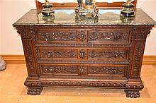 A superb 19th century walnut three drawer commode having all over carved de