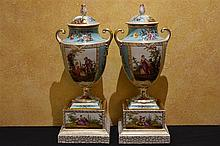 A finest pair of Royal Crown Dresden two handled vases supported on pedasta