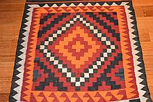 A Persian tribal rug. Length 104cm, Width 78cm