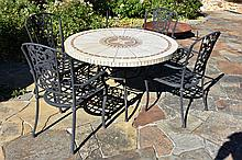 A wrought iron base occasional outdoor table having mosaic inlaid top.
