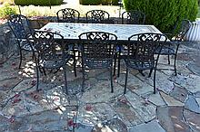 A wrought iron base outdoor table having mosaic inlaid top Height 75cm, Wid