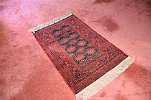 A hand woven pure wool Persian carpet with geometric decoration. Length 152