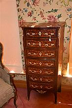 A good French 19th century serpentine shaped rosewood seven drawer chest wi
