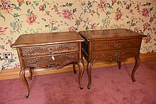 A fine pair of French 19th century two drawer kingwood commodes with carved