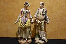 A good pair of Dresden 19th century porcelain figures depicitng the flower